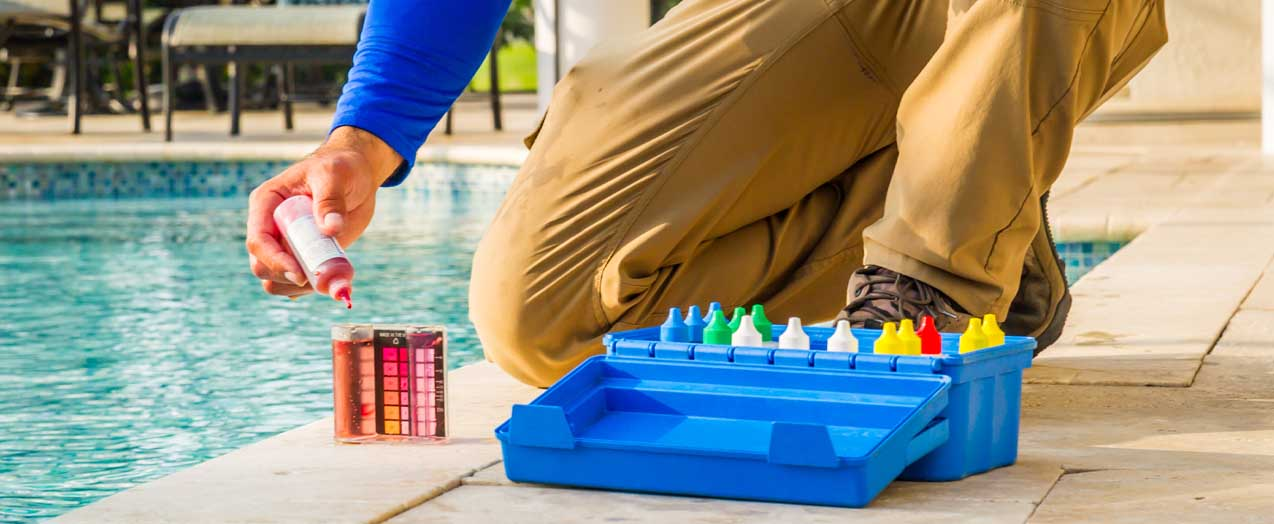 Pool Technician Performing a Water Quality Test | Edgewater Pools and Spa Services - Naples, Bonita Springs, Isles of Capri, & Estero