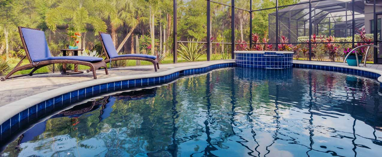 Pool with Lounge Chairs | Edgewater Pools and Spa Services - Naples, Bonita Springs, Isles of Capri, & Estero