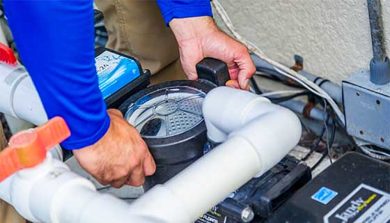 Pool Technician Checking Pump | Edgewater Pools and Spa Services - Naples, Bonita Springs, Isles of Capri, & Estero