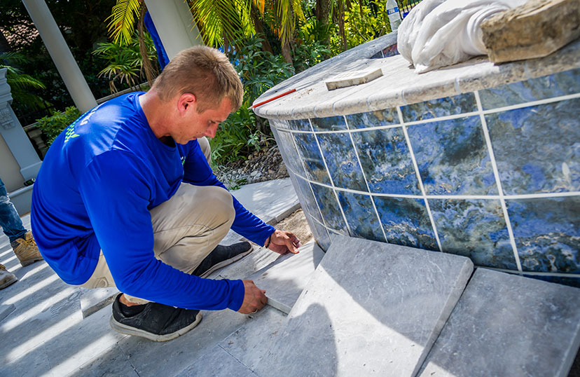 Installing Outdoor Tiles | Edgewater Pool Service Naples